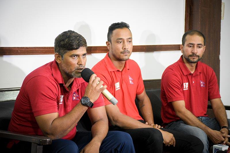 National cricket team head coach Umesh Patwal speaks as skipper Paras Khadka (centre) and team manager Raman Shiwakoti look on during a press meet in Kathmandu on Sunday. Photo: Naresh Shrestha / THTu00a0