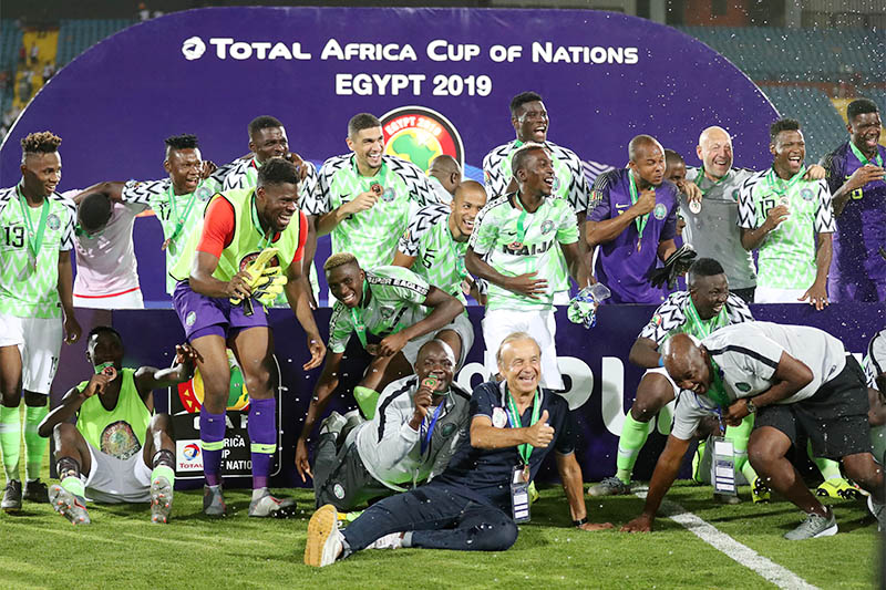 Nigeria coach Gernot Rohr celebrates with team mates after winning the Third Place Play Off. Photo: Reuters