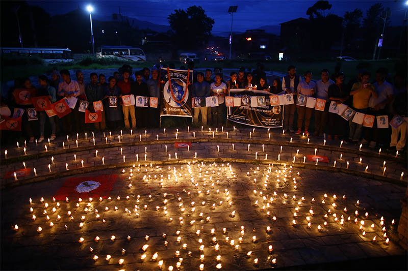 Students light candles during a candle light vigil of Nirmala Panta to mark the 1st anniversary of her death after she was raped and murdered in Kanchanpur district on July 26, 2018, in Kathmandu on Friday. Nirmala's parents are still seeking justice for their 13-year-old daughter. Photo/Skanda Gautam