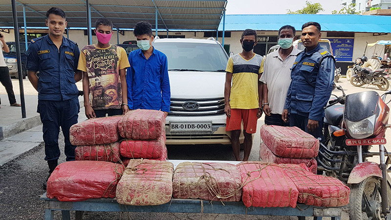 District Police Office making public four persons arrested in possesion of 120 kilograms of marijuana, in Parsa, on Thursday, July 18, 2019. Photo: Ram Sarraf/THT