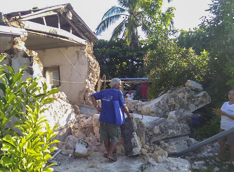 A resident looks at damaged houses in Itbayat town, Batanes islands, northern Philippines following the earthquakes Saturday, July 27, 2019. Photo: Agnes Salengua Nico via AP