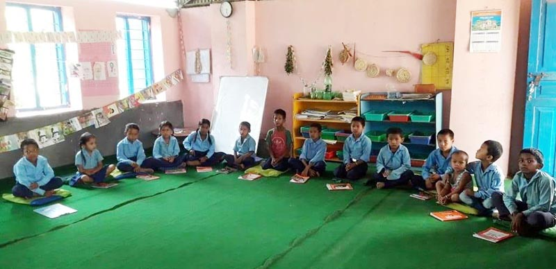 Children attending class in Jhike Pokhari Secondary School of Tapli Rural Municipality, Udayapur, on Tuesday. The Jalpa Integrated Development Society-run education project had managed the teaching-learning materials. Photo: THT