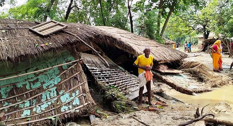 A man standing in front of his flood-damaged house in Durga Bhagawati Rural Municipality of Rautahat district, on Monday, July 15, 2019. Photo: THT