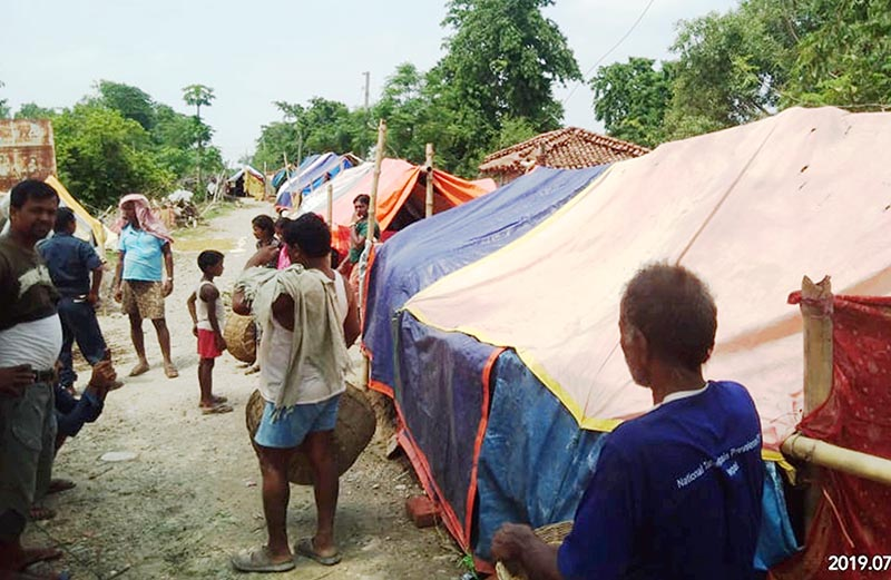 Flood victims standing outside thier makeshift tents, in Rautahat district, on Tuesday, July 16, 2019. Photo: THT