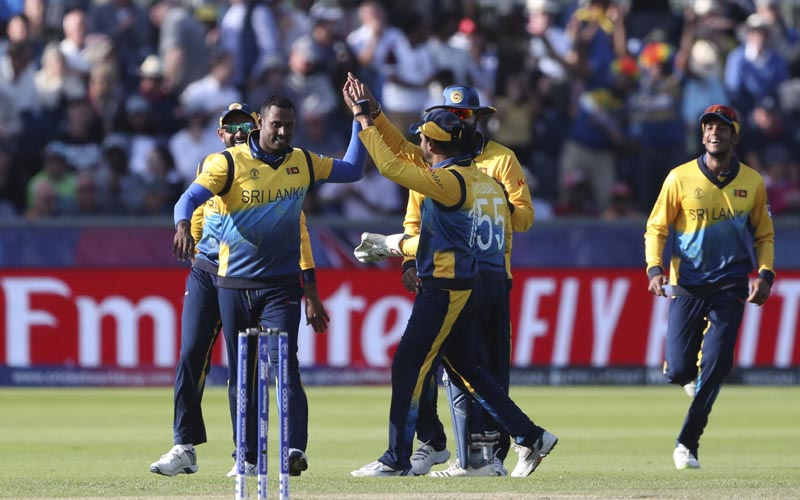 Sri Lanka's bowler Angelo Mathews (left) celebrates with teammates after dismissing West Indies' batsman Nicholas Pooran for 118 runs during the Cricket World Cup match between Sri Lanka and the West Indies at the Riverside Ground in Chester-le-Street, England, Monday, July 1, 2019. Photo: AP