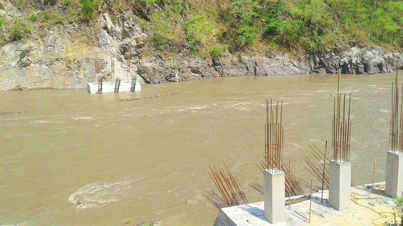 A view of an under-construction bridge over the Saptakoshi River that has been left incomplete  for eight years due to the contractoru2019s negligence, in Phoksingtar, on Tuesday, July 9, 2019. Photo: THT