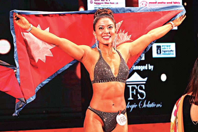 Nepal's Mallika Shakya celebrates after winning gold medal during the 12th South Asian Body building and Physique Sports Championship in Kathmandu on Saturday, July 20, 2019. Photo: Udipt Singh Chhetry/ THT