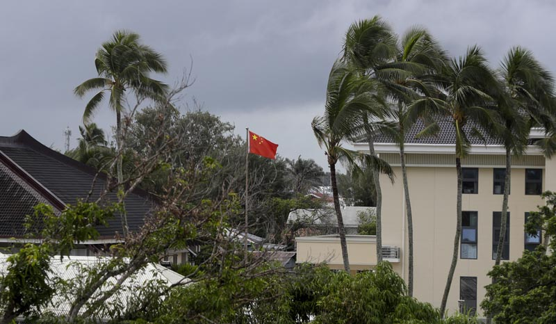 In this April 8, 2019, photo, a Chinese flag flies outside the Chinese Embassy in Nuku'alofa, Tonga. China is pouring billions of dollars in aid and low-interest loans into the South Pacific, and even in the far-flung kingdom of Tonga there are signs that a battle for power and influence among much larger nations is heating up and could exact a toll. Photo: AP