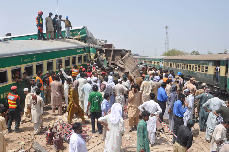 Residents and rescue workers gather near the site after a passenger train collided with a cargo train in Sadiqabad, Pakistan July 11, 2019. Photo: Reuters