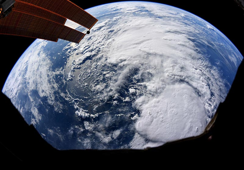 This file satellite image provided by NASA and taken by US astronaut Christina Koch on Thursday, July 11, 2019 at the International Space Station, shows Tropical Storm Barry as it bears down on Texas, Louisiana, Alabama and the panhandle of Florida as it makes its way through the Gulf of Mexico. Photo: Christina Koch/NASA via AP/ File