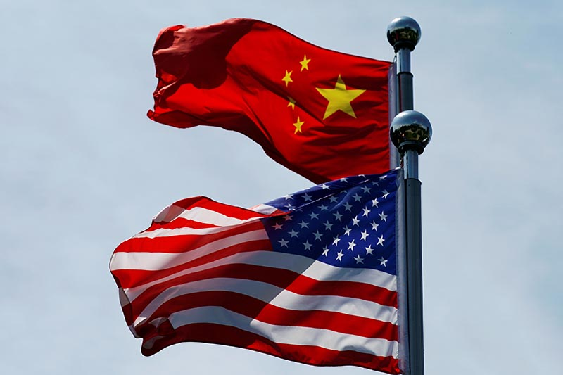 Chinese and US flags flutter near The Bund, before US trade delegation meet their Chinese counterparts for talks in Shanghai, China July 30, 2019.  Photo: Reuters