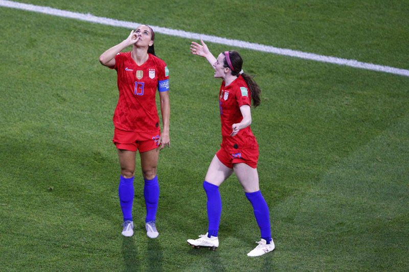 United States' Alex Morgan, left, celebrates her side's second goal during the Women's World Cup semifinal soccer match between England and the United States, at the Stade de Lyon outside Lyon, France, Tuesday, July 2, 2019. Photo: AP