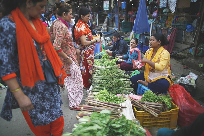 People buying vegetables from street vendors at a market, in Kathmandu, on Sunday, July 28, 2019. Photo: Skanda Gautam/THT