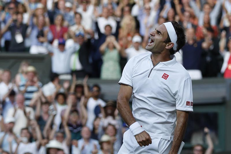 Switzerland's Roger Federer celebrates after beating Spain's Rafael Nadal in a Men's singles semifinal match on day eleven of the Wimbledon Tennis Championships in London, Friday, July 12, 2019. Photo: AP