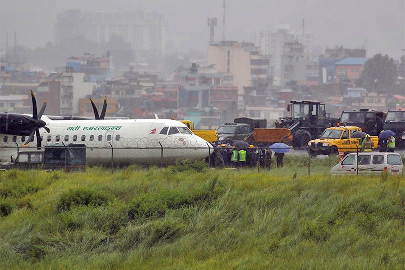 A Yeti Airlines plane lies near the runway after it skidded off while landing at Tribhuvan International Airport in Kathmandu, on Friday, July 12, 2019. Photo: Reuters