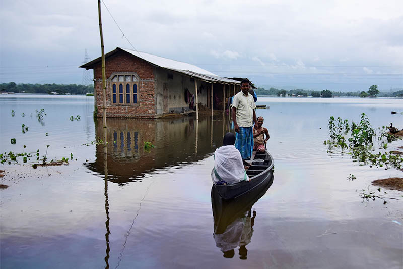 Villagers are transported on a boat towards a safer place at a flooded village in Nagaon district, in the northeastern state of Assam, India, on Monday, July 15, 2019. Photo: Reuters