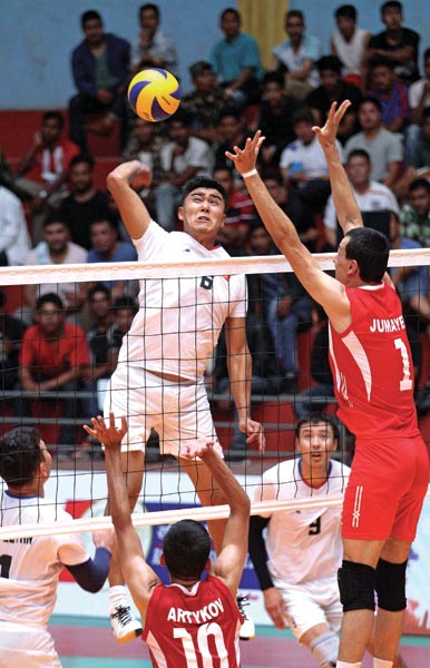 Idirisov Emil of Kyrgyzstan jumps for a spike against Turkmenistan during their AVC Asian Senior Menu0092s Central Zone Volleyball Championship semi-final match in Lalitpur on Thursday, August 22, 2019. Photo: THT