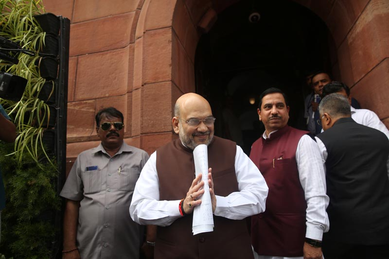 India's Home Minister Amit Shah greets the media upon his arrival at the parliament in New Delhi, India, August 5, 2019. Photo: Amit Shah