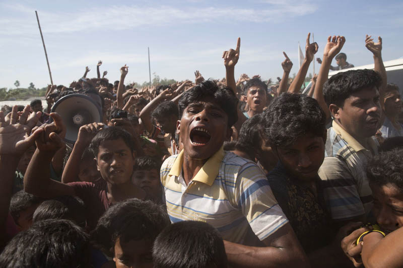Rohingya refugees shout slogans during a protest against the repatriation process at Unchiprang refugee camp near Cox's Bazar, in Bangladesh, Thursday, November 15, 2018. Photo: AP/File