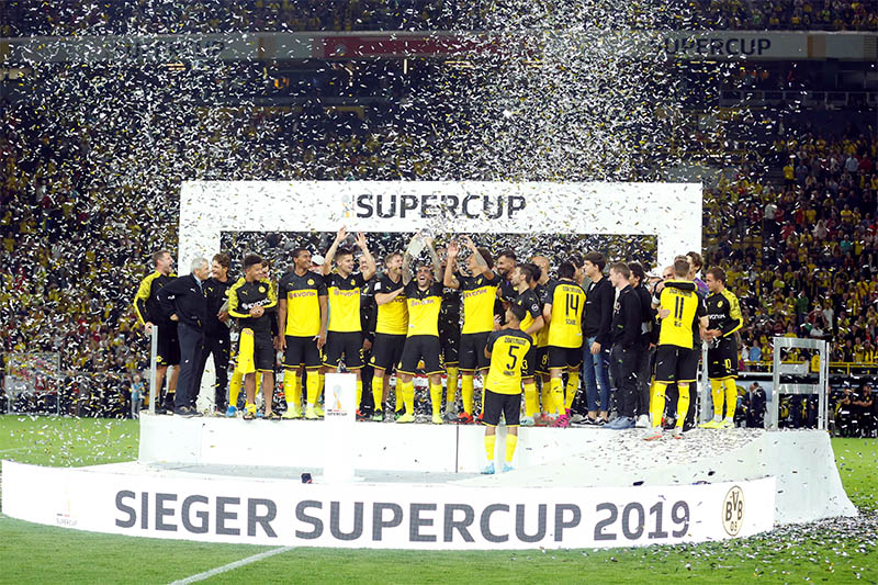 Borussia Dortmund celebrate with the trophy after winning the German Super Cup. Photo: Reuters