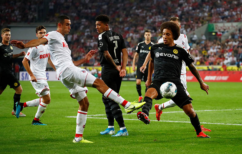 FC Cologne's Ellyes Skhiri in action with Borussia Dortmund's Axel Witsel during the Bundesliga  match between FC Cologne and Borussia Dortmund, at Rhein Energie Stadion, in Cologne, Germany, on August 23, 2019. Photo: Reuters