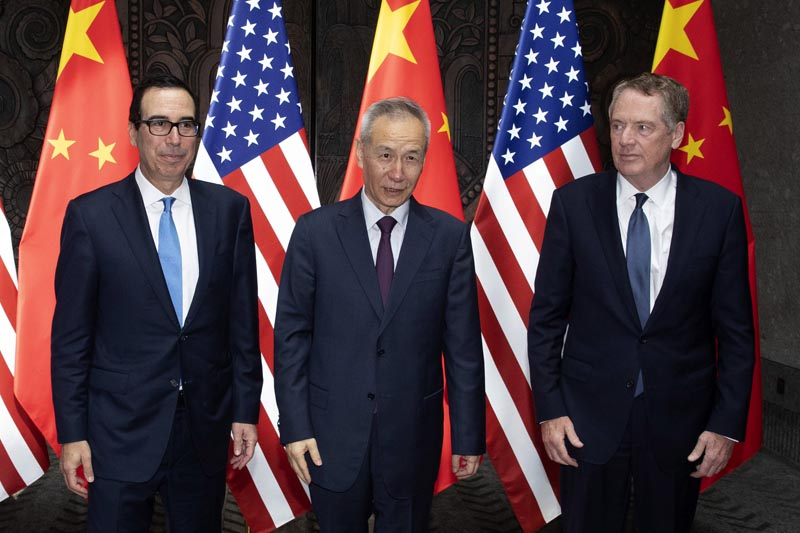 Chinese Vice Premier Liu He, center, poses with US Trade Representative Robert Lighthizer (right) and Treasury Secretary Steven Mnuchin, for photos before holding talks at the Xijiao Conference Center in Shanghai Wednesday, July 31, 2019. Photo: AP