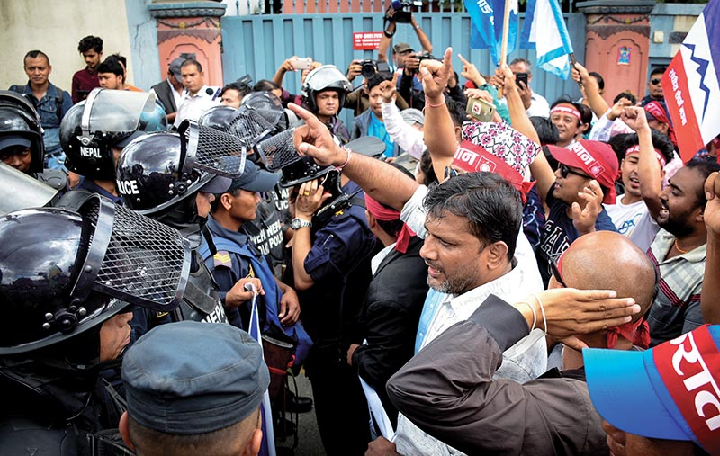 Agitators protestion the FPSC' job announcement demanding that the social inclusion provision be im plemented, in Baluwatar, Kathmandu, on Tuesday. Photo: THT