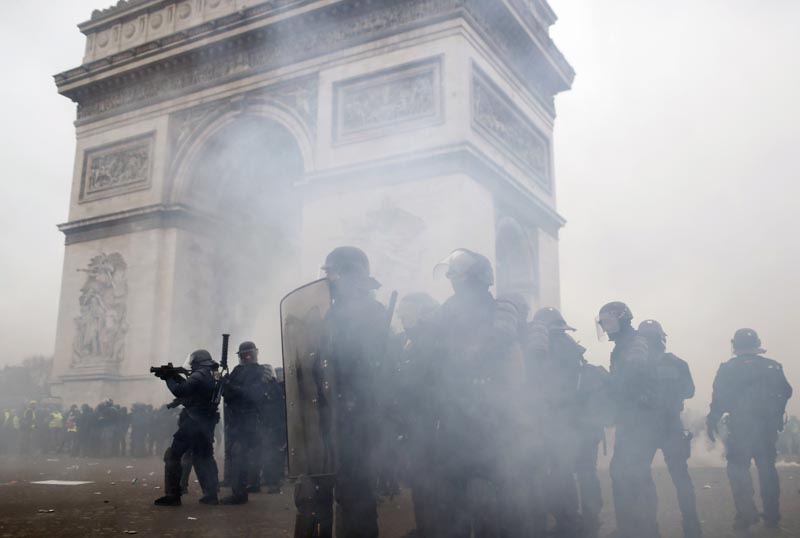 FILE - In this Saturday, January 12, 2019 file photo riot police take position around the Arc de Triomphe during clashes with yellow vest protesters, in Paris, France. Photo: AP