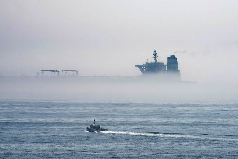 A view of the Grace 1 supertanker is seen through the sea fog, in the British territory of Gibraltar, Thursday, August 15, 2019, seized last month in a British Royal Navy operation off Gibraltar. Photo: AP