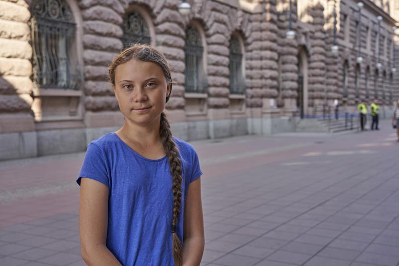 In this photo taken on Friday, July 26, 2019, Greta Thunberg stands next to Swedish parliament in Stockholm. Photo: AP