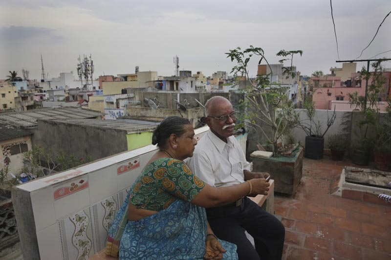 In this July 18, 2019, photo, retired Indian civil servant R Devarajan with his wife Padmini sit at the terrace of their house equipped with rain water harvesting system in Chennai, India. Photo: AP