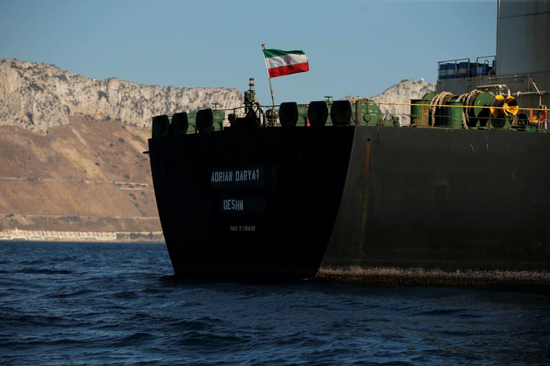 The Iranian flag flies at Iranian oil tanker Adrian Darya 1, before being named as Grace 1, as it sits anchored after the Supreme Court of the British territory lifted its detention order, in the Strait of Gibraltar, Spain, August 18, 2019. REUTERS/Jon Nazca