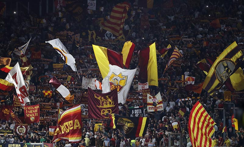 Roma's supporters wave flags during the Serie A soccer match between Roma and Genoa at the Rome Olympic stadium, Sunday, Aug. 25, 2019. Photo: AP
