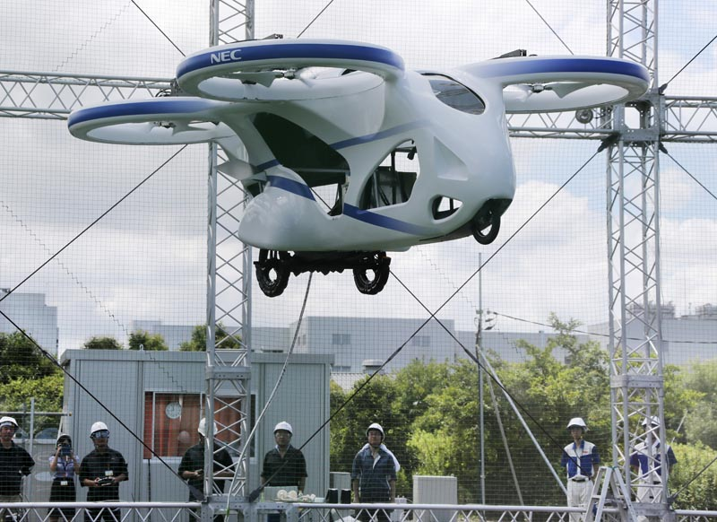 NEC Corp's machine with propellers hovers at the company's facility in Abiko near Tokyo, Monday, August 5, 2019. Photo: AP