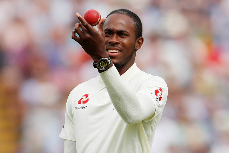 England's Jofra Archer checks the ball. Photo: Reuters