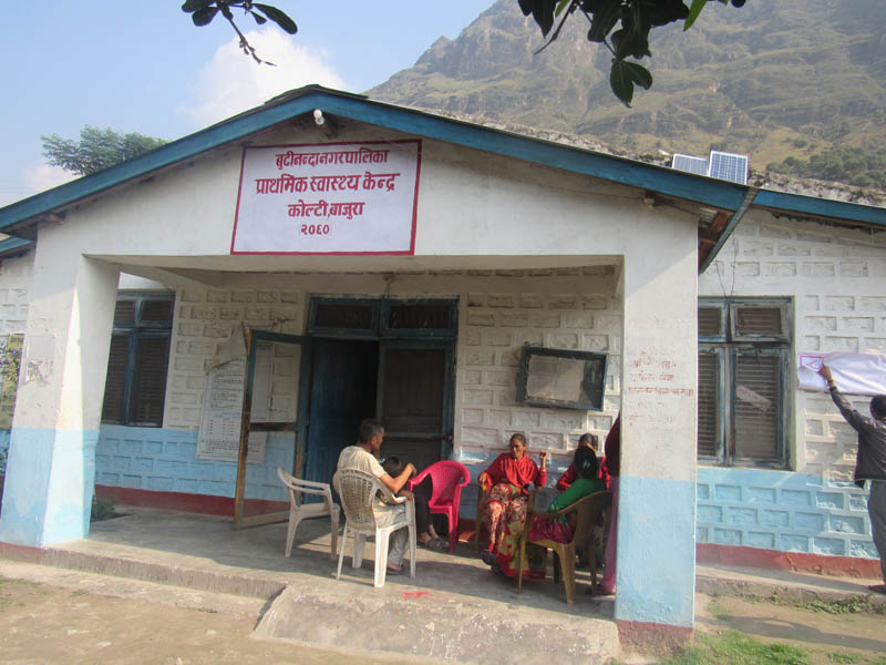 Locals sit on the porch of Primary Health Centre, Kolti, in Budhinanda Municipality, Bajura District, on August 27, 2019. The health centre witnesses the highest number of maternity service seekers in the district. Photo: Prakash Singh/THT
