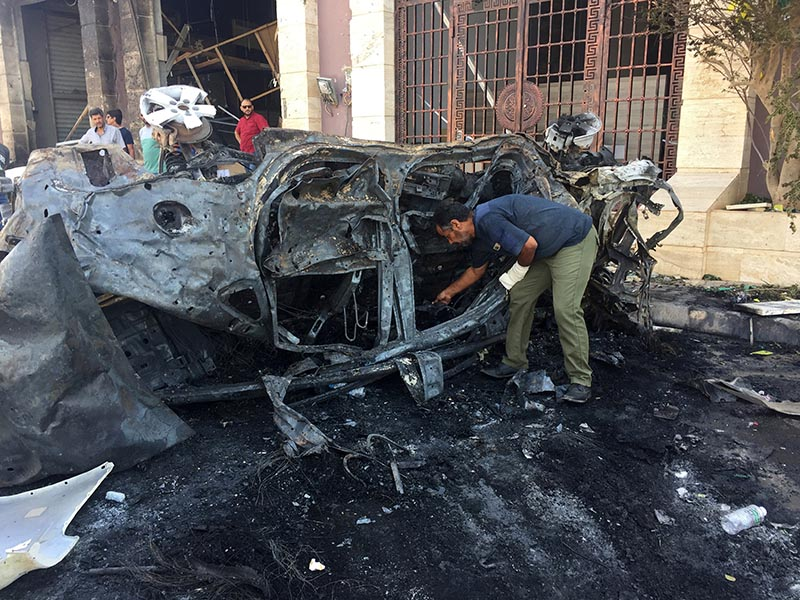 A security official inspects the site where a car bomb exploded in Benghazi, Libya August 10, 2019. Photo: Reuters