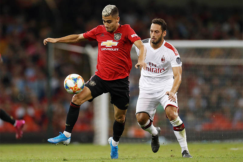 Manchester United's Andreas Pereira in action with AC Milan's Hakan Calhanoglu. Photo: Reuters