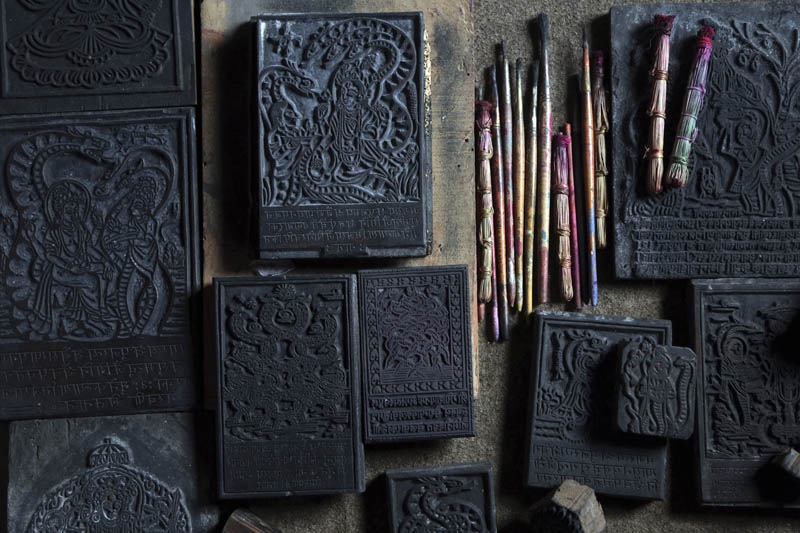 Wooden stamps which are used to make traditional paintings are displayed at the residence of Chitrakar couple Tej Kumari and Purna, in Bhaktapur, Nepal, July 31, 2019. Photo: AP