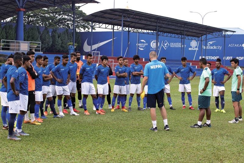 The file photo shows Nepal national football team head coach Johan Kalin lending lessons to players. Photo Courtesy: ANFA