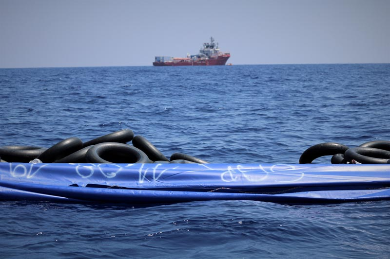 The migrant rescue ship Ocean Viking, run by French charities Medecins Sans Frontieres and SOS Mediterranee, floats in the distance, as it waits in international waters between Malta and the southern Italian island of Linosa for access to a port in this handout picture taken between August 9 and 12, 2019. Photo: Ocean Viking/Handout via Reuters