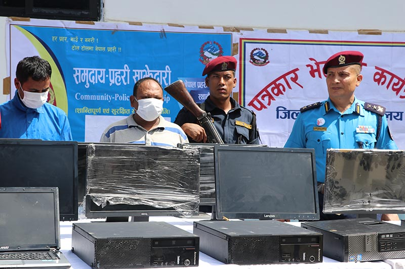 Police parade arrestees u2014 Kishor Thapa (second from left) arrested for stealing from various ward offices of Pokhara Metropolis and Ropchandra Gopali (left) for purchasing the stolen items u2014 during a press meet organised at Kaski District Police Office, in Pokhara, on Wednesday, August 14, 2019. Photo: Rishi Baral/THT