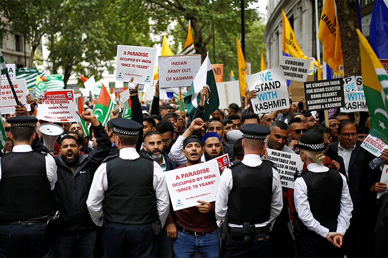 Demonstrators hold banners during a protest against the scrapping of the special constitutional status in Kashmir by the Indian government, outside the Indian High Commission in London, Britain, August 15, 2019. Photo: Reuters