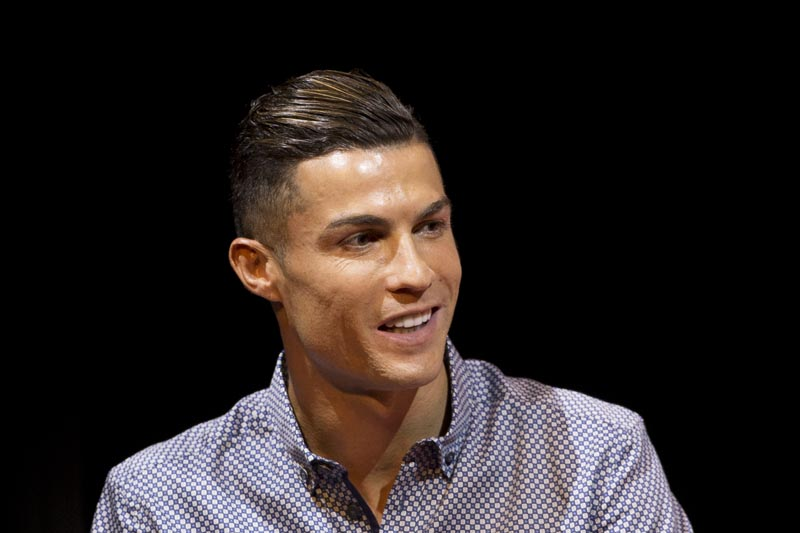 Juventus soccer player Cristiano Ronaldo speaks after receiving the Lifetime Achievement award given by the Spanish sports paper 'Marca', in Madrid, Spain, Monday, July 29, 2019. Photo: AP