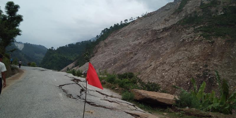 A view of a road that caved in due to erosion caused by the Budhiganga River along the Sanphe-Martadi road section in Budhiganga Municipality, Bajura, on Monday, August 12, 2019. Photo: THT