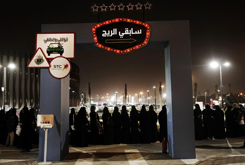 FILE - In this June 22, 2018, file photo, women wait in line to ride go carts at a road safety event for female drivers launched at the Riyadh Park Mall in Riyadh. Photo: AP