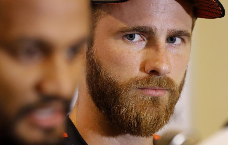 New Zealand's cricket captain Kane Williamson, right, watches as his Sri Lankan counterpart Dimuth Karunaratne speaks during a media briefing on the eve of their first test cricket match in Galle, Sri Lanka, Tuesday, August 13, 2019. Photo: AP