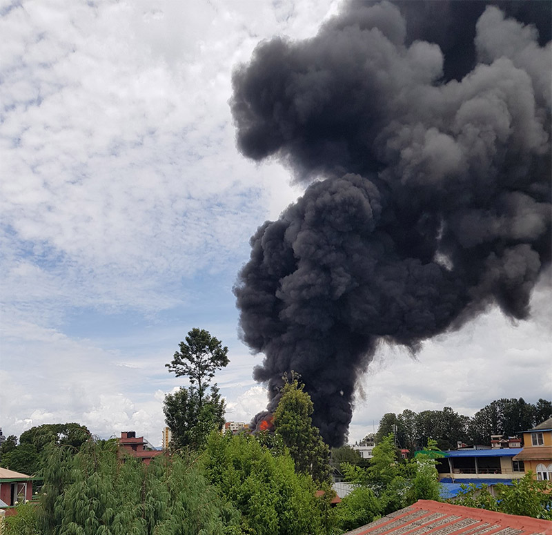 A view of smoke bellowing from Subisu premises after a building caught fire, on Wednesday, August 7, 2019. Photo Courtesy: Semanta Dahal/Twitter
