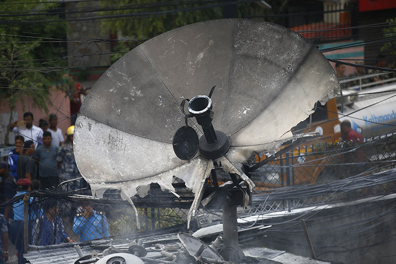 A satellite antenna is pictured after the building of Subisu, the internet service provider, caught fire, in Baluwatar, Kathmandu, on Wednesday, August 07, 2019. Photo: Skanda Gautam/THT