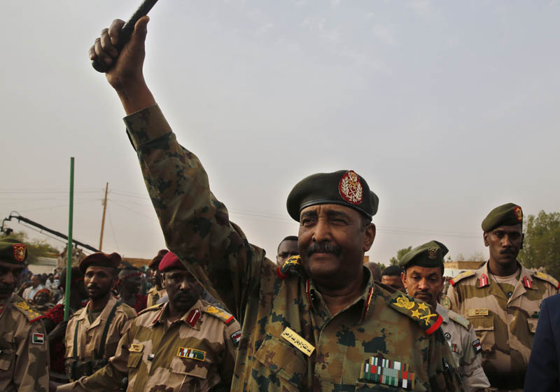 Sudanese Gen Abdel-Fattah Burhan, head of the military council, waves to his supporters upon his arrival to attend a military-backed rally, in Omdurman district, west of Khartoum, Sudan, June 29, 2019. Photo: AP/File